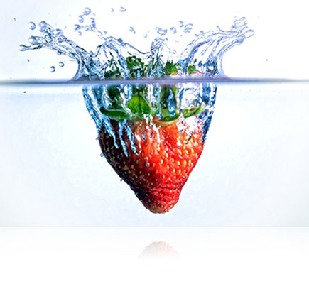 Photo of a strawberry splashing into water, shot using the AF-S DX NIKKOR 18-105mm f/3.5-5.6G ED VR lens